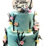 Two tier fondant covered cake with toy sparrows and chocolate branches