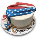 Fondant covered cake with fondant flag and rope