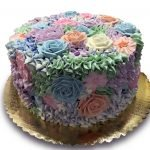 Cake covered in buttercream flowers