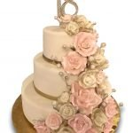 Three tier fondant covered cake with large gumpaste roses