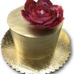 Simple gold airbrushed cake with maroon gumpaste peony