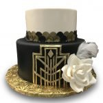 Fondant covered black and gold art deco style cake with gumpaste rose