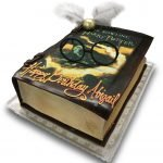 Fondant and scan covered Harry Potter book cake with fondant glasses and snitch