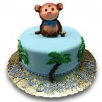 Cute fondant monkey on fondant covered cake