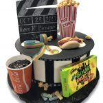 Fondant covered movie themed birthday cake with candy and popcorn