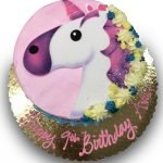 Buttercream cake with fondant unicorn and fondant flowers