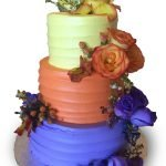 Colorful three tier homespun cake with fresh roses