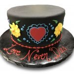 Fondant covered Dia de los Muertos wedding cake with buttercream drawings