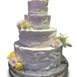 Homestyle wedding cake with live flowers