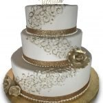 Three tier fondant covered wedding cake with buttercream lace and ribbon