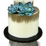 Buttercream cake brushed gold with gumpaste succulents