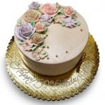 Birthday cake with pastel flowers in beige, lavender and blush