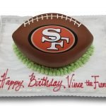 Football shaped fondant covered cake with 49ers scan
