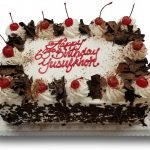 Black forest sheet cake with red writing