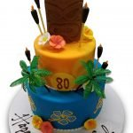 Two tiered fondant covered tiki tropical birthday cake