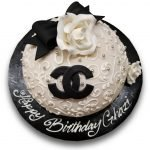 Black and white chanel princess cake with gumpaste rose and bow