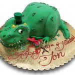 Tyrannosaurus Rex shaped cake covered in fondant