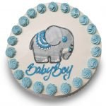 Buttercream elephant drawing with blue buttercream rosettes