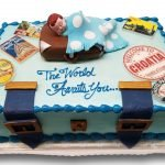 Suitcase baby shower cake with assorted fondant stamps and clasps