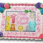 Cute zoo animal scan birthday cake with assorted roses and pink scrolls