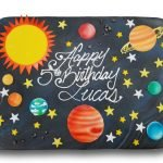 Marbled fondant covered birthday cake with fondant planets and sugar stars