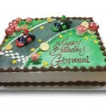 Mario kart birthday cake with chocolate coins and mushrooms and sugar stars