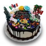fun and random birthday cake with flags, roses, animals and hula dancer