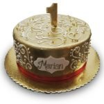 Gold fondant and scrollwork birth-day cake