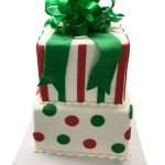 Fondant covered two tier presents cake with gumpaste bow