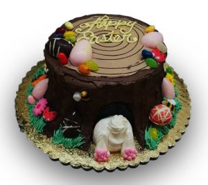 easter bunny hiding under a tree stump cake