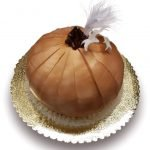Pumpkin shaped cake with feather and gumpaste leaves