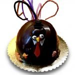 Turkey shaped Thanksgiving cake poured in ganache