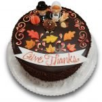 Thanksgiving cake with pilgrims, turkey and sugar leaves