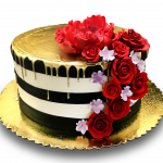 Black and white buttercream stripe with gold drip and gumpaste flowers