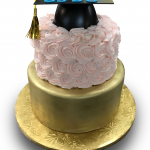 Pastel rose and gold graduation cake