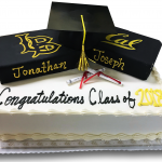 Graduation cake with cap and books