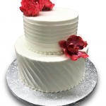 Homespun wedding cake with coral red gumpaste flowers