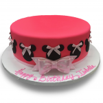 Fondant covered Minnie Mouse cake with bows