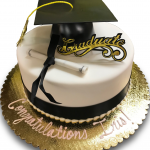 Simple graduation cake with cap, scroll and ribbon